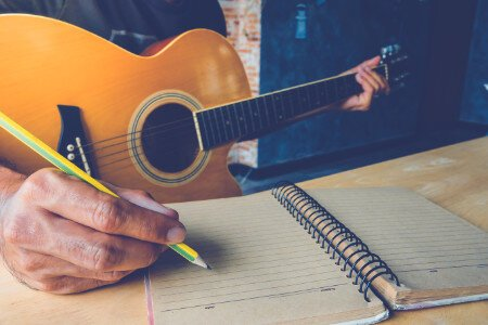 man writing song acoustic guitar songwriting guitar lesson.jpg